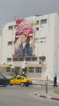 Poster of Mohamed Bouazizi in Sidi Bouzid. Bouazizi burnt himself in protest at the government, igniting the Arab Spring.
