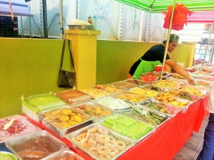 Street vendor in Brickfields selling a delicious array of snacks.